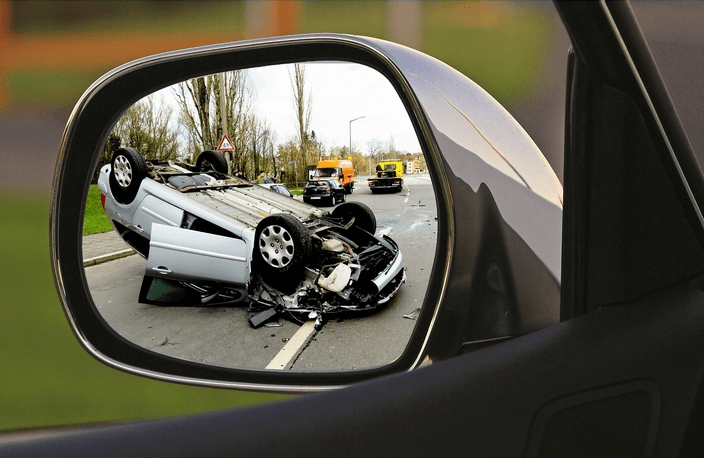 Reflection-of-car-accident-car-upside-down