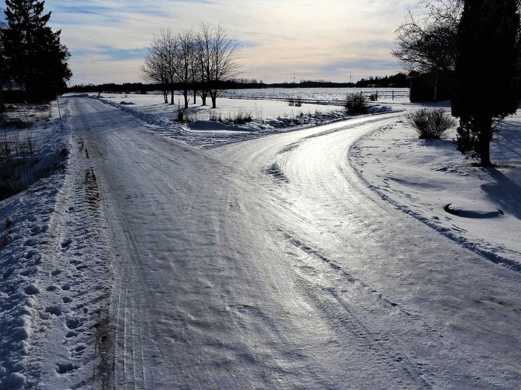 fork in the road in the country with iced over roads